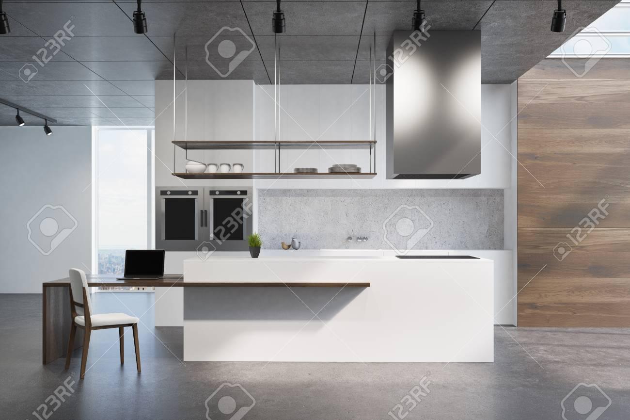 comptoir de cuisine blanc et en bois debout sur un sol gris fonce dans une piece avec des murs en bois et blancs et des fenetres de loft maquette 3d