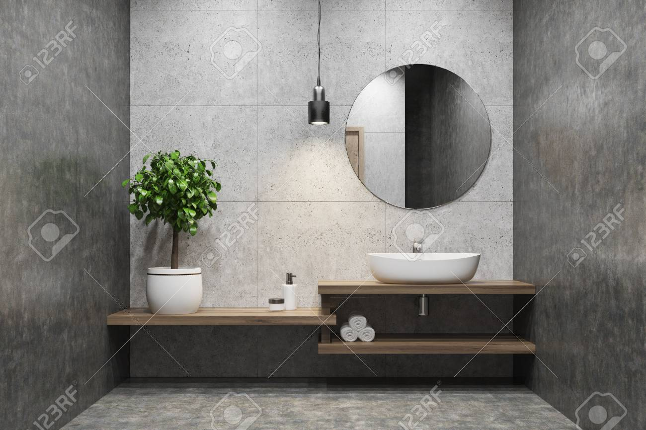 concrete bathroom interior with a wooden shelf a sink standing