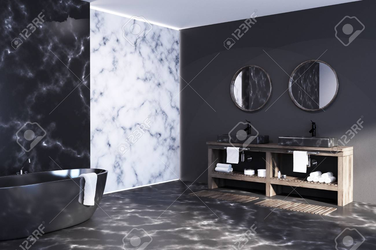 white and black marble bathroom with a black tub standing on