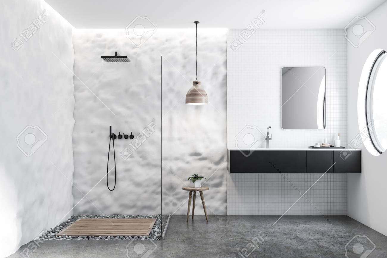 white tile and crude wall bathroom interior with black sink