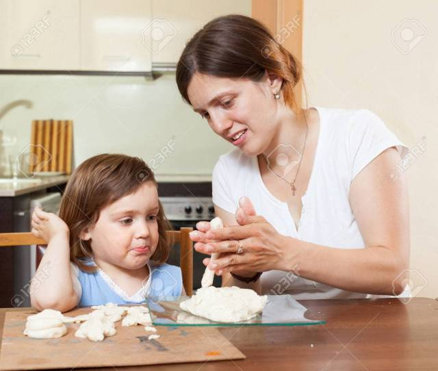 Mom Teaches The Girl To Mold Dough Figurines In The Room Stock Photo 29926049