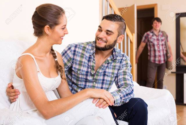 Stock Photo Upset Adult Discovering Cheating Partner At Home