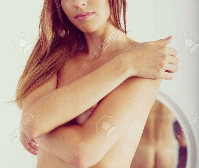 Sexy Young Naked Woman Standing Close To Mirror In Bedroom Stock Photo