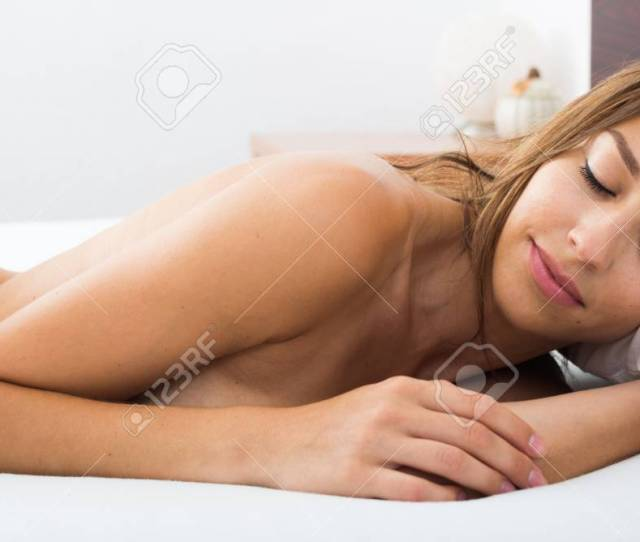 Young Relaxed Sexy Naked Woman Lying In Bed At Morning Stock Photo