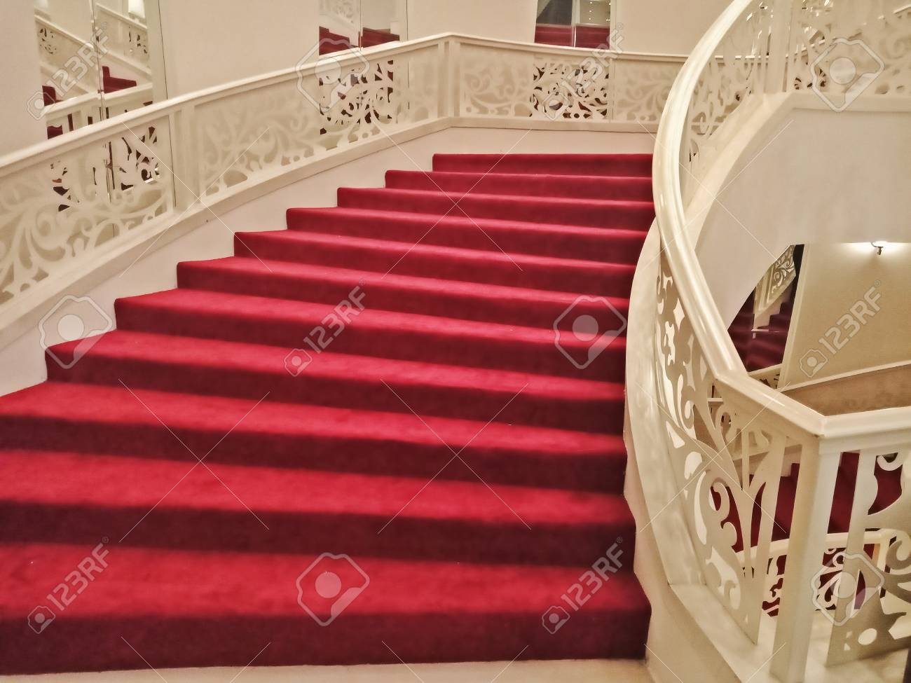 Interior House With Curved Stair And Red Carpet Stock Photo | Stairs With Red Carpet | Event | Gold | Spiral Staircase | Traditional | White