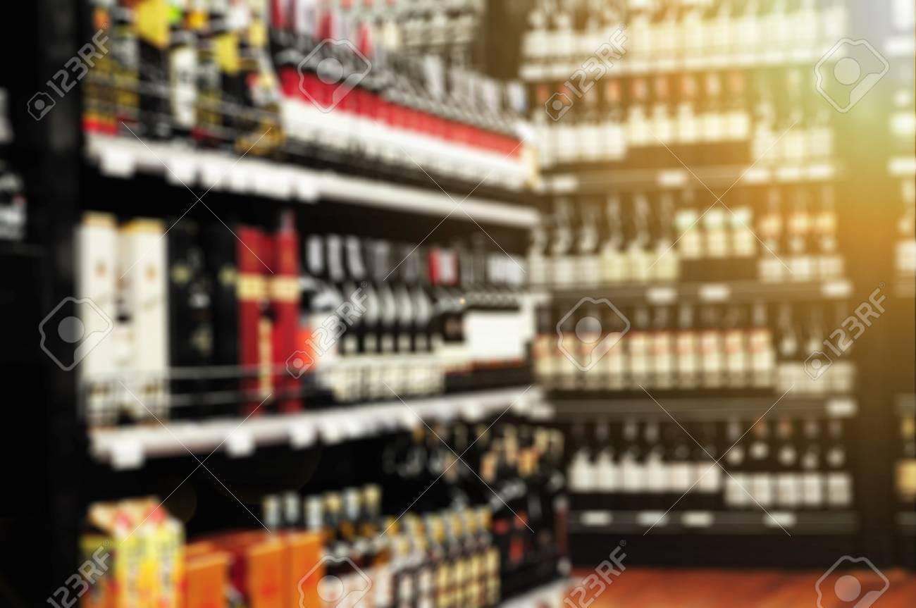 Wine Liquor Bottle On Shelf Blurred Supermarket Store Blur Background
