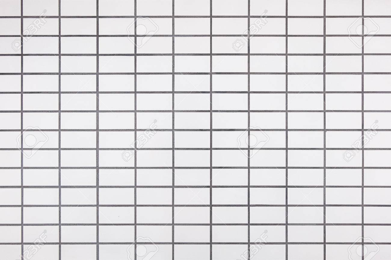 closeup texture of white ceramic tiles seam bricks on the wall