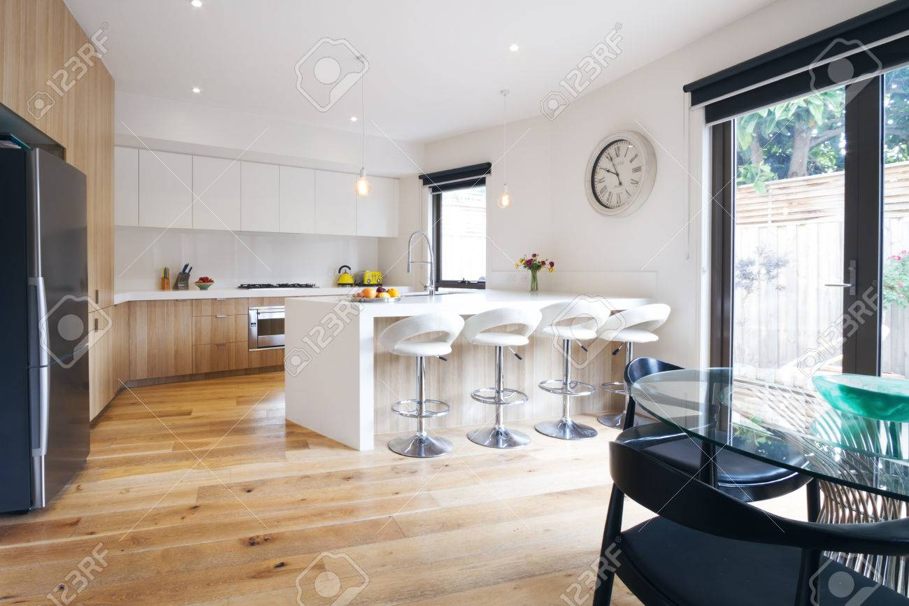 Modern Open Plan Kitchen With Island Bench And Bar Stools Stock Photo Picture And Royalty Free Image Image 48470595