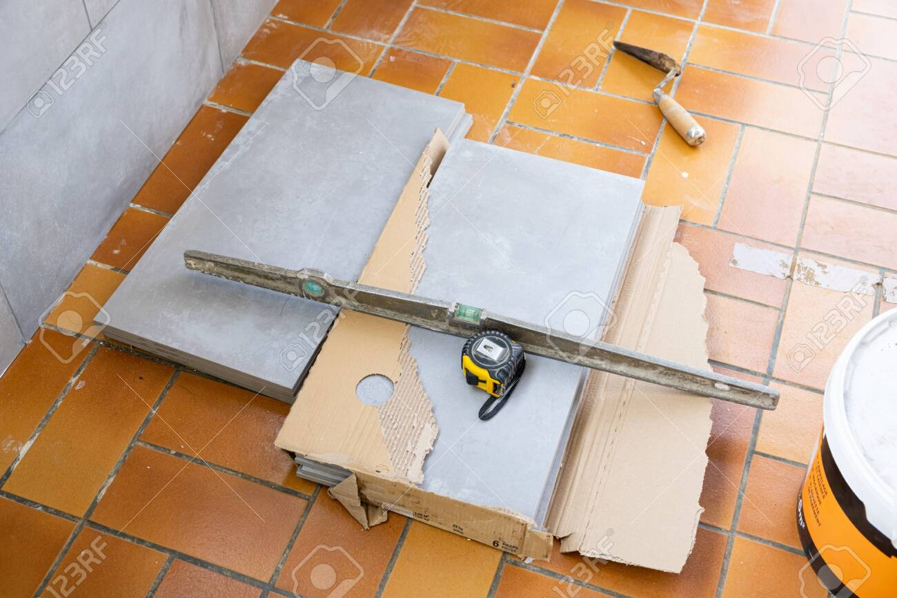 https www 123rf com photo 138014048 ceramic tile installation site with its tools html