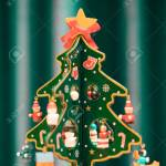 Painted Wooden Christmas Tree With Green Background And Copy Stock Photo Picture And Royalty Free Image Image 92018468