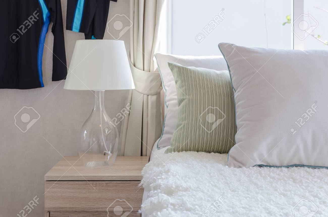 Modern Glass Lamp On Wooden Side Table In Bedroom At Home