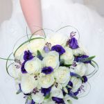 Bride Holding Bouquet Of White Rose And Purple Flowers On Wedding Stock Photo Picture And Royalty Free Image Image 19689090