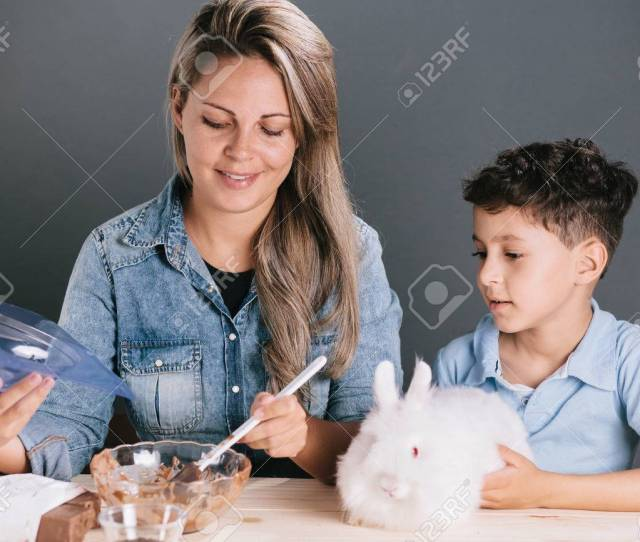 Mom And Son Making Homemade Easter Eggs Stock Photo 72757750