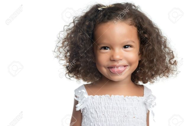 little girl with an afro hairstyle smiling and wearing a white..
