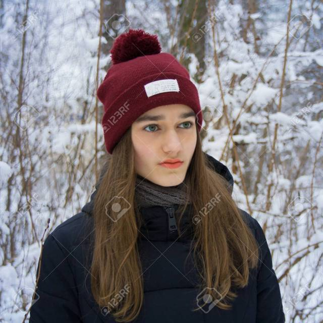 Stock Photo Winter Portrait Of Serious Cute Beautiful Attractive Young Teen Girl With Long Blonde Hair With Gray Green Eyes On Natural Gentle Blurred Blue