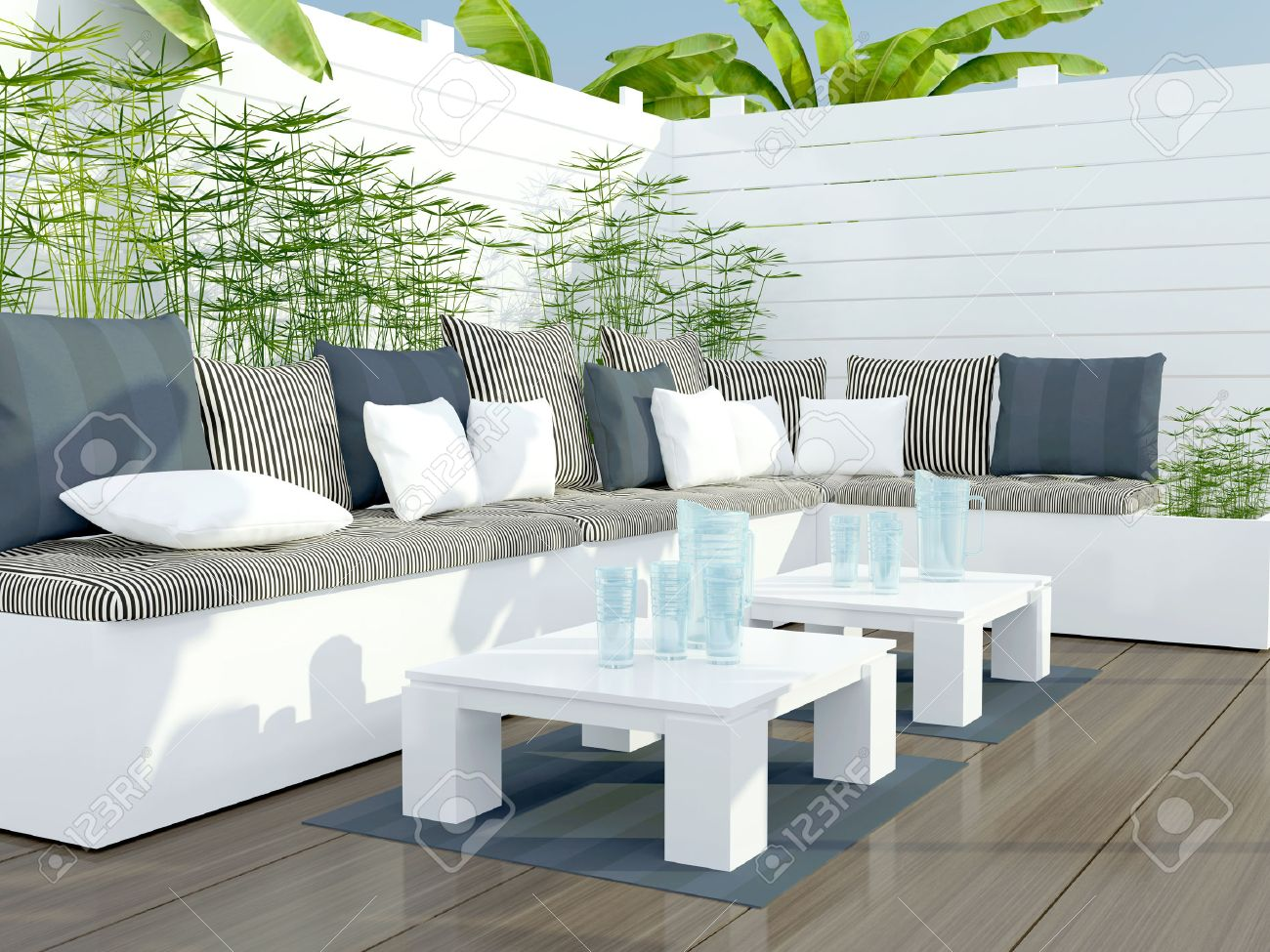 outdoor patio seating area with big white sofa and table