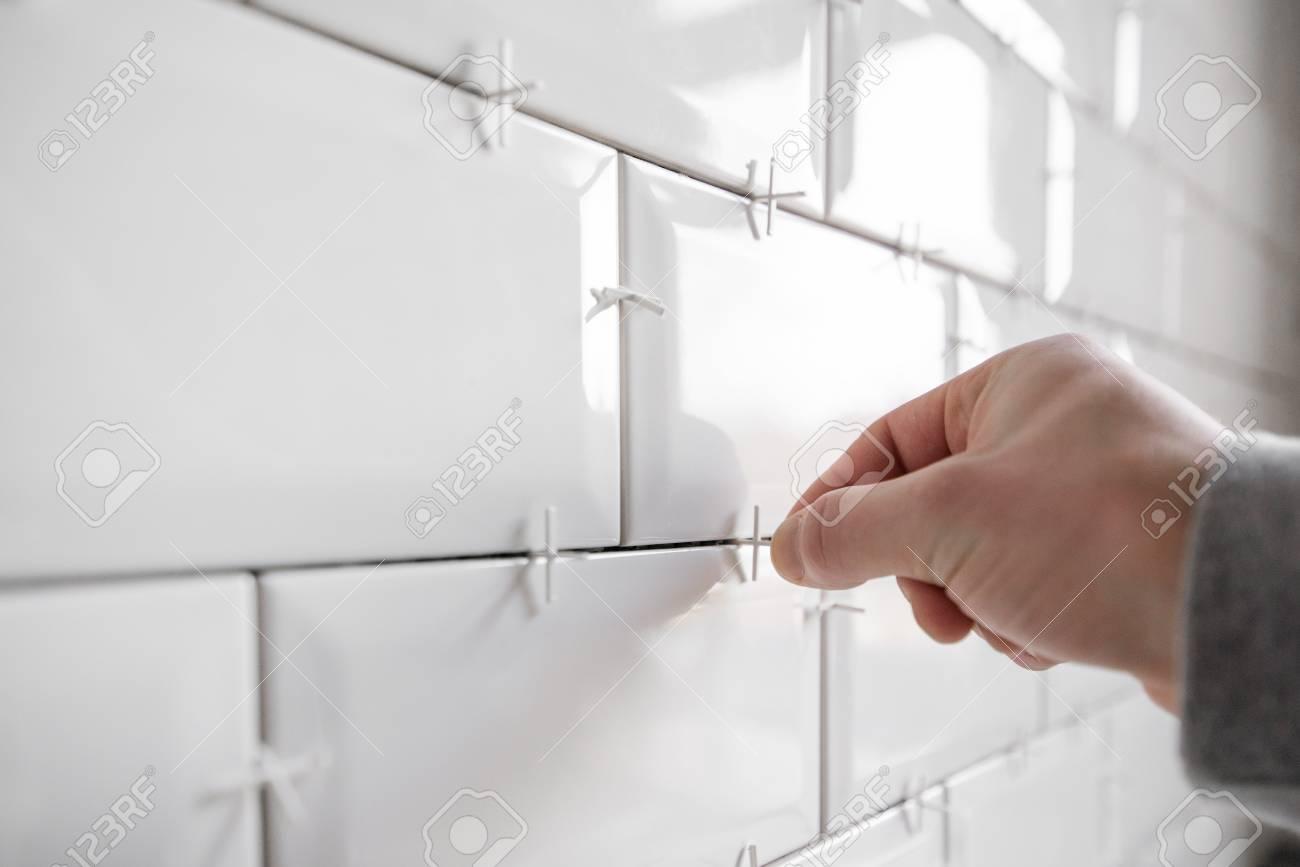 https www 123rf com photo 118856508 ceramic tile lying installing new subway or metro tile in bathroom shower or kitchen back splash dur html