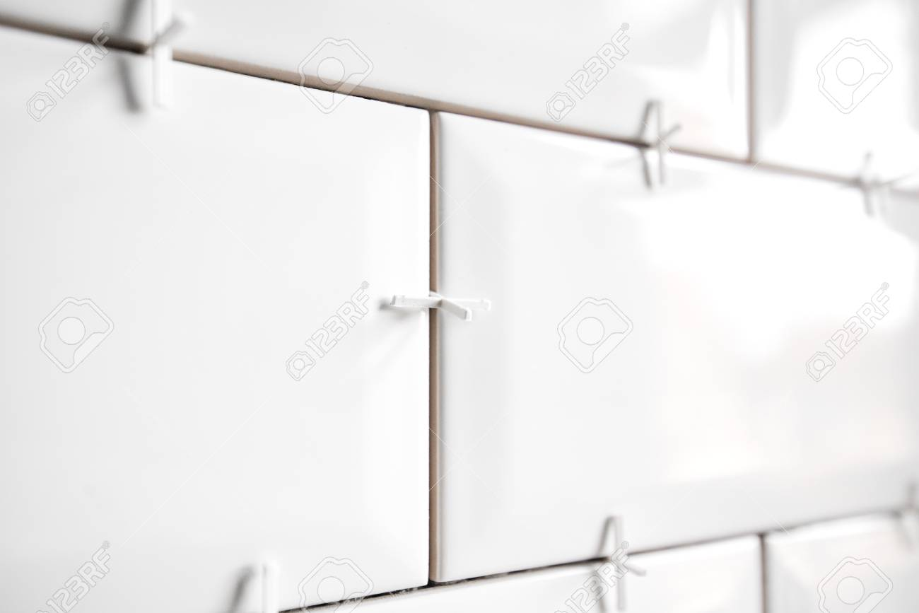 https www 123rf com photo 118859442 ceramic tile lying installing new subway or metro tiles in bathroom shower or kitchen back splash du html