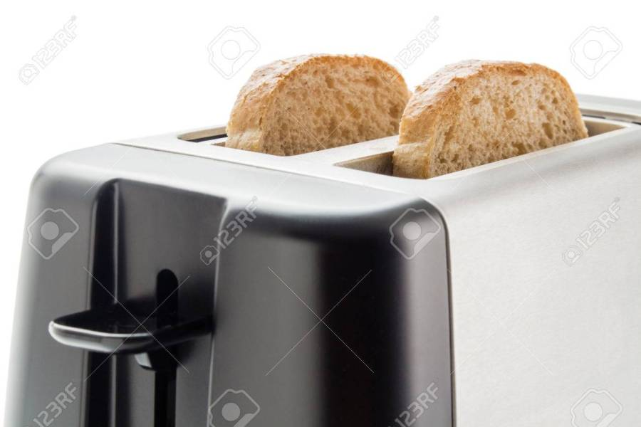 Toaster With Bread Slices  Electric Toaster With Two Wholemeal     Stock Photo   Toaster with bread slices  Electric toaster with two  wholemeal bread slices close up isolated on white background