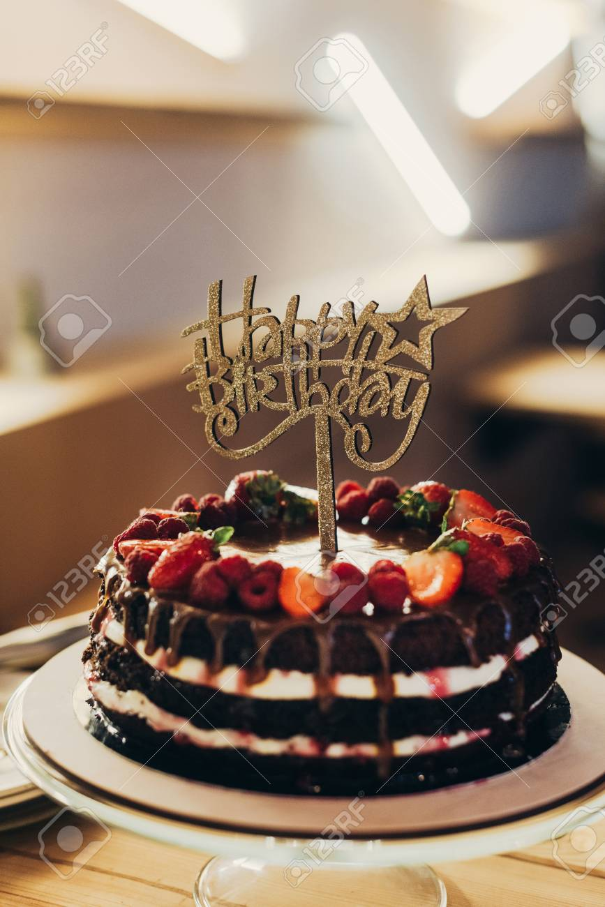 Happy Birthday Sign On Chocolate Cake With Fruits Stock Photo Picture And Royalty Free Image Image 98682074