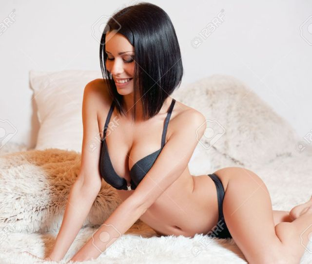 Portrait Of A Sexy Young Brunette Woman Wearing Lingerie Stock Photo 52892366