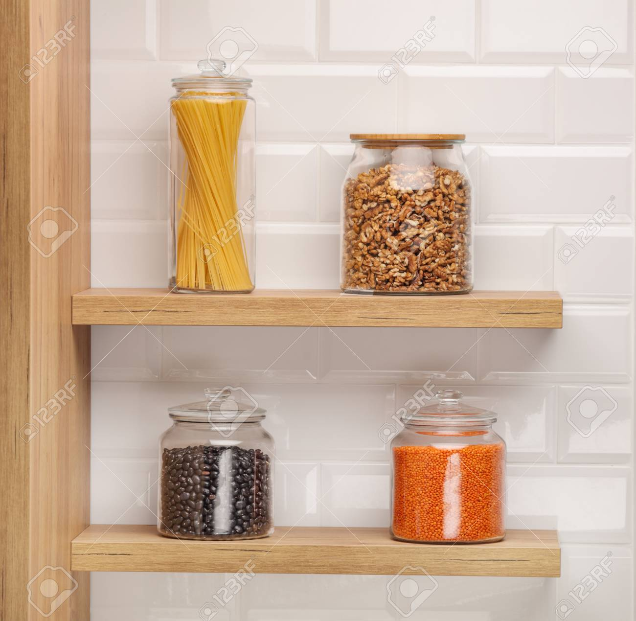 Glass Jars On Wooden Kitchen Shelves Filled With Spaghetti Walnuts Stock Photo Picture And Royalty Free Image Image 117124716
