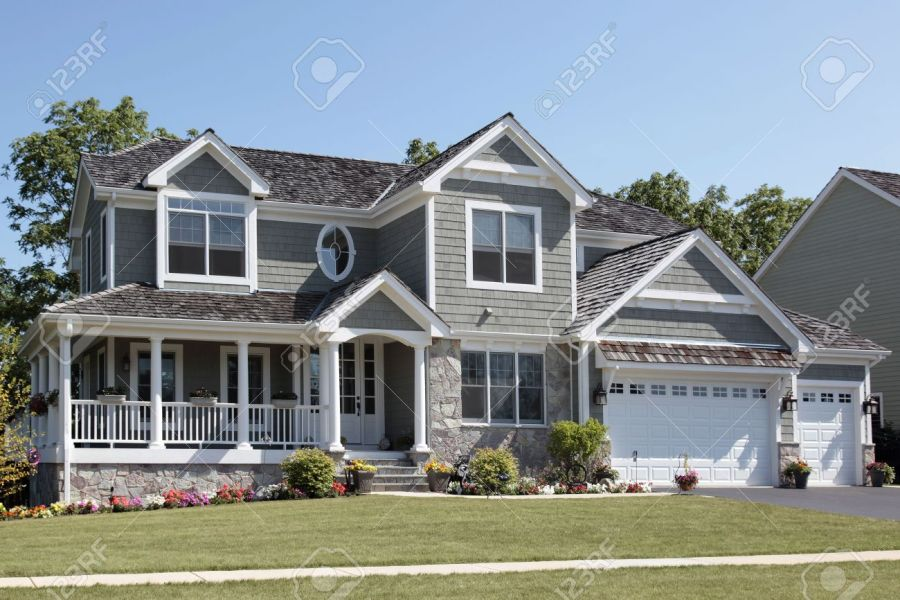 Suburban Home With Wraparound Porch And Columns Stock Photo  Picture     Stock Photo   Suburban home with wraparound porch and columns