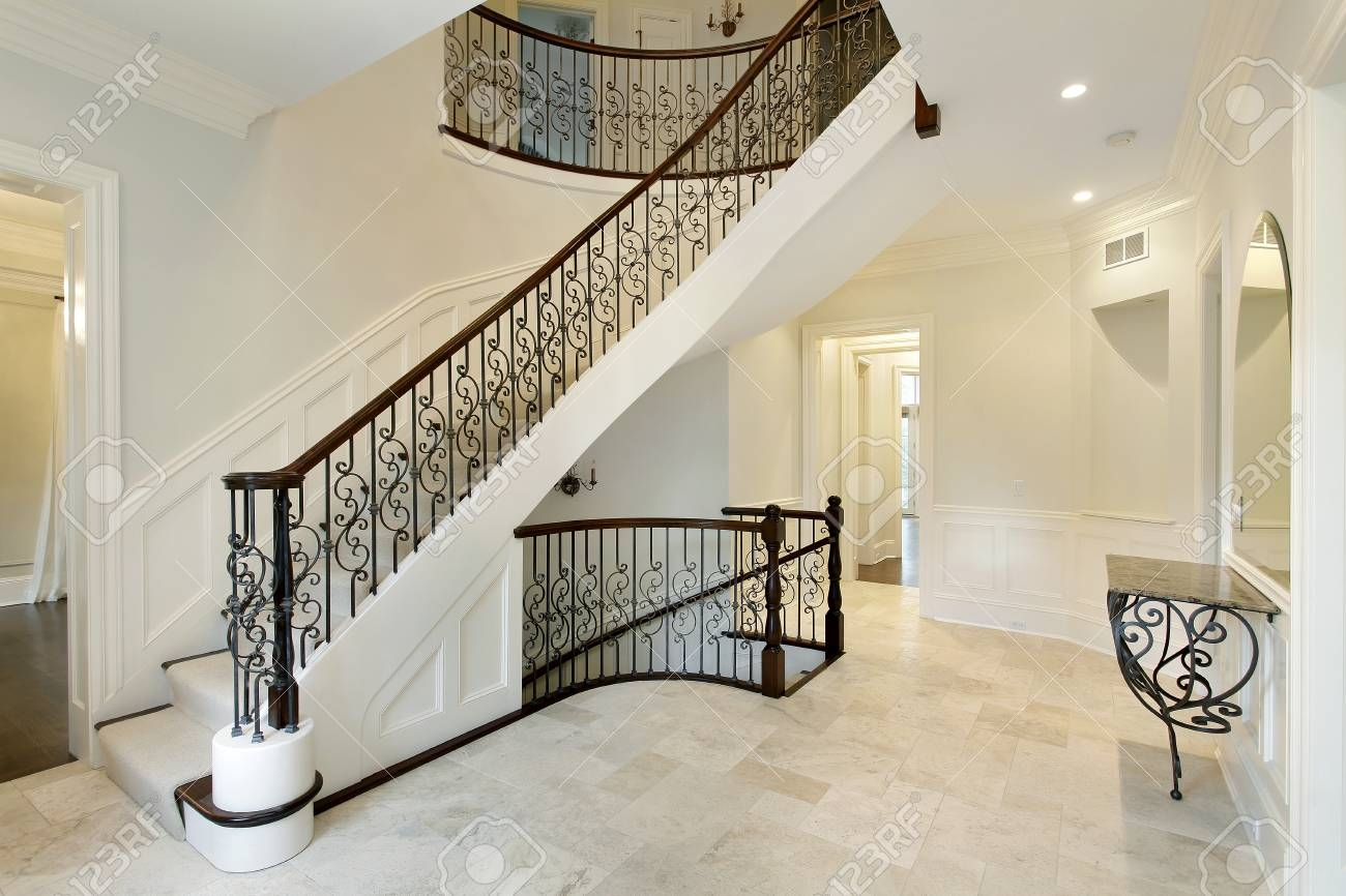 Foyer In Suburban Home With Wrought Iron Staircase Railing Stock   Wrought Iron Stair Railing   Italian   Front Porch   French   Mediterranean   Design