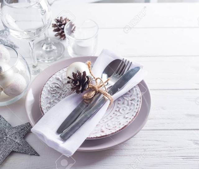 Silver And Cream Christmas Table Setting With Christmas Decorations On Wooden Background Copy Space Stock