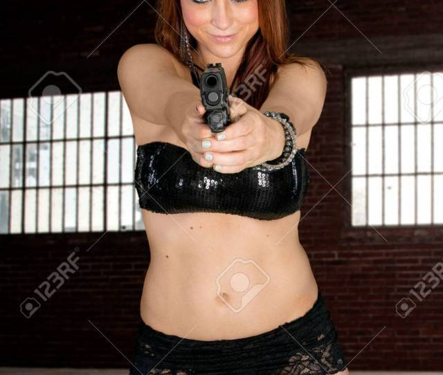 Hot Redhead In Lingerie With Handgun Pointed At You Stock Photo