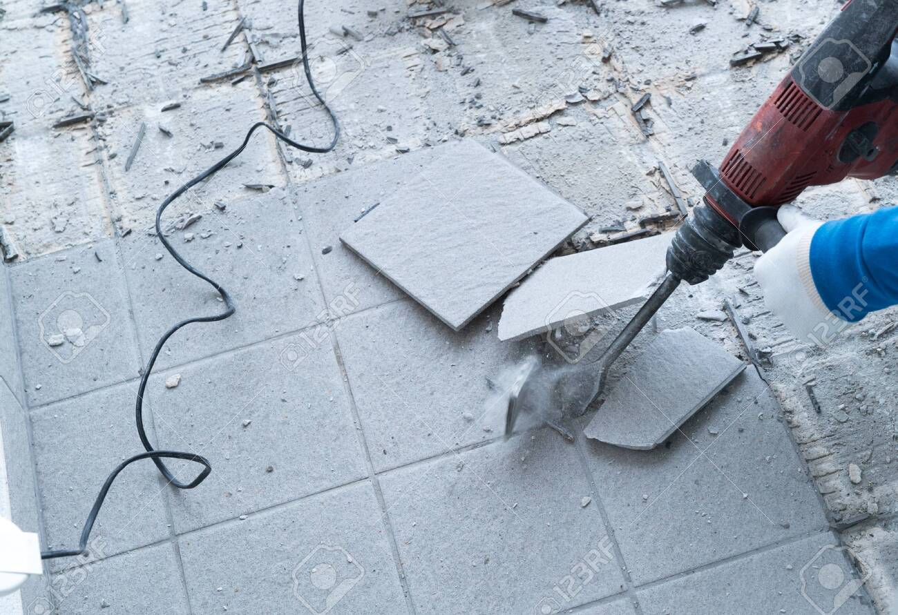 https www 123rf com photo 130070752 detail view of a construction worker using a handheld demolition hammer and wall breaker to chip awa html