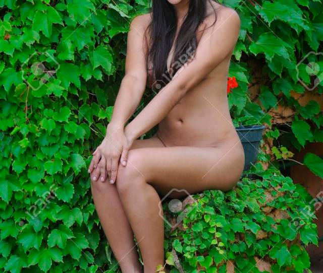 Beautiful Young Girl Naked On The Green Leaves Stock Photo