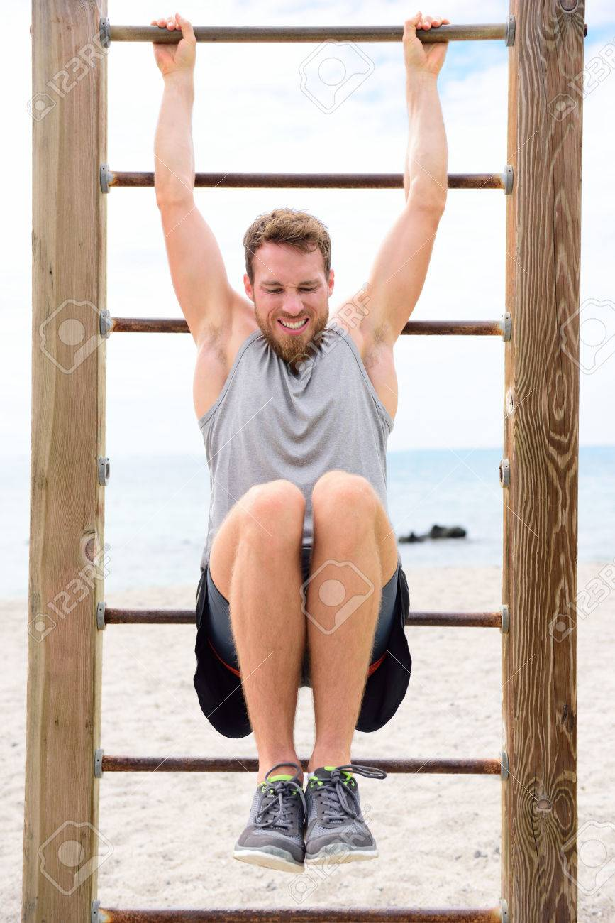 https www 123rf com photo 36001775 fitness people man training abs by lifting legs on cross fit bar rack outside on outdoor gym station html