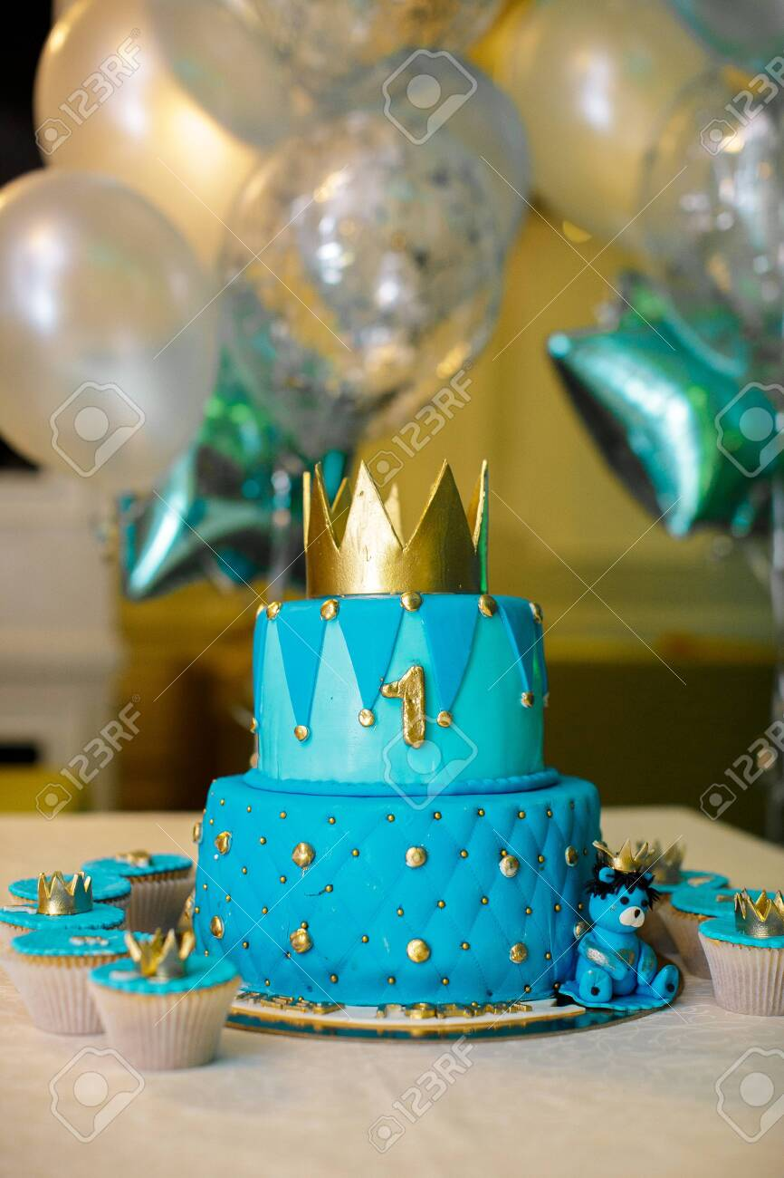 1 Year Birthday Cake In Blue With A Gold Crown Stock Photo Picture And Royalty Free Image Image 146025605