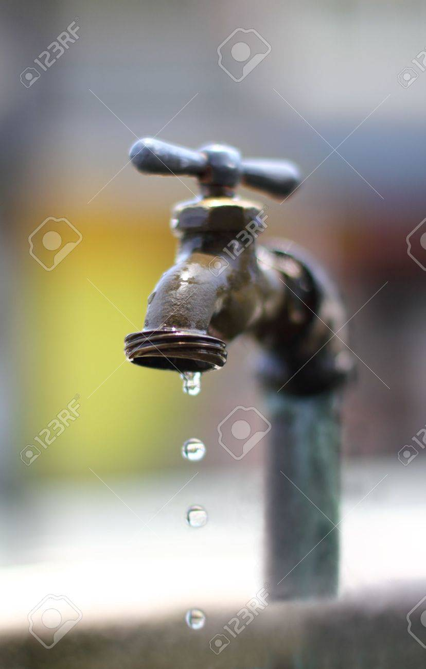dripping water on an old faucet
