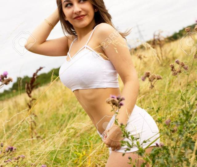 Sexy Girl Wearing A Croptop And Hot Pants Outdoors Stock Photo 63690502