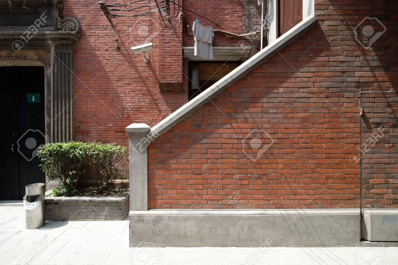 Brick Wall For Staircase Outside The Living House In Traditional | Staircase Outside House Design | Curved | Modern | Cool | Residential | Up Balcony
