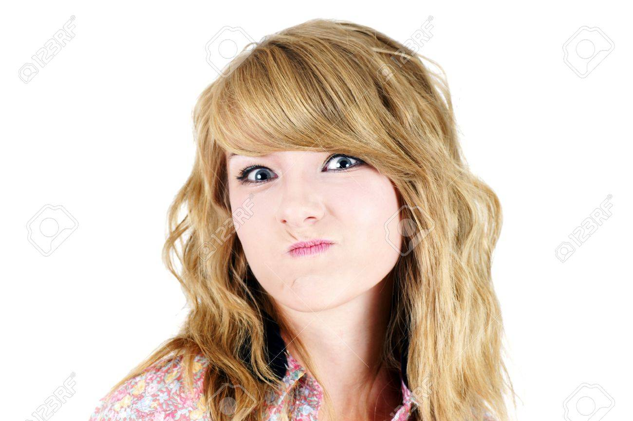 Cute Young Blond Teenager Girl Making A Funny Unhappy Or Upset Face Studio Shot On