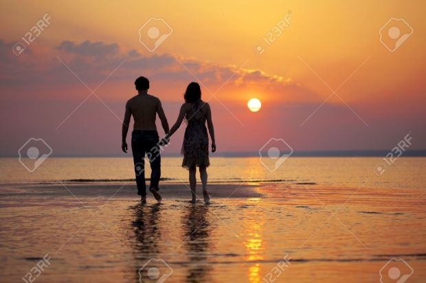 The Image Of Two People In Love At Sunset Stock Photo, Picture And Royalty  Free Image. Image 9038335.
