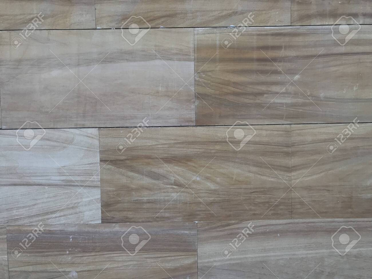 wall tiles designed like laminate wood grains pattern for an