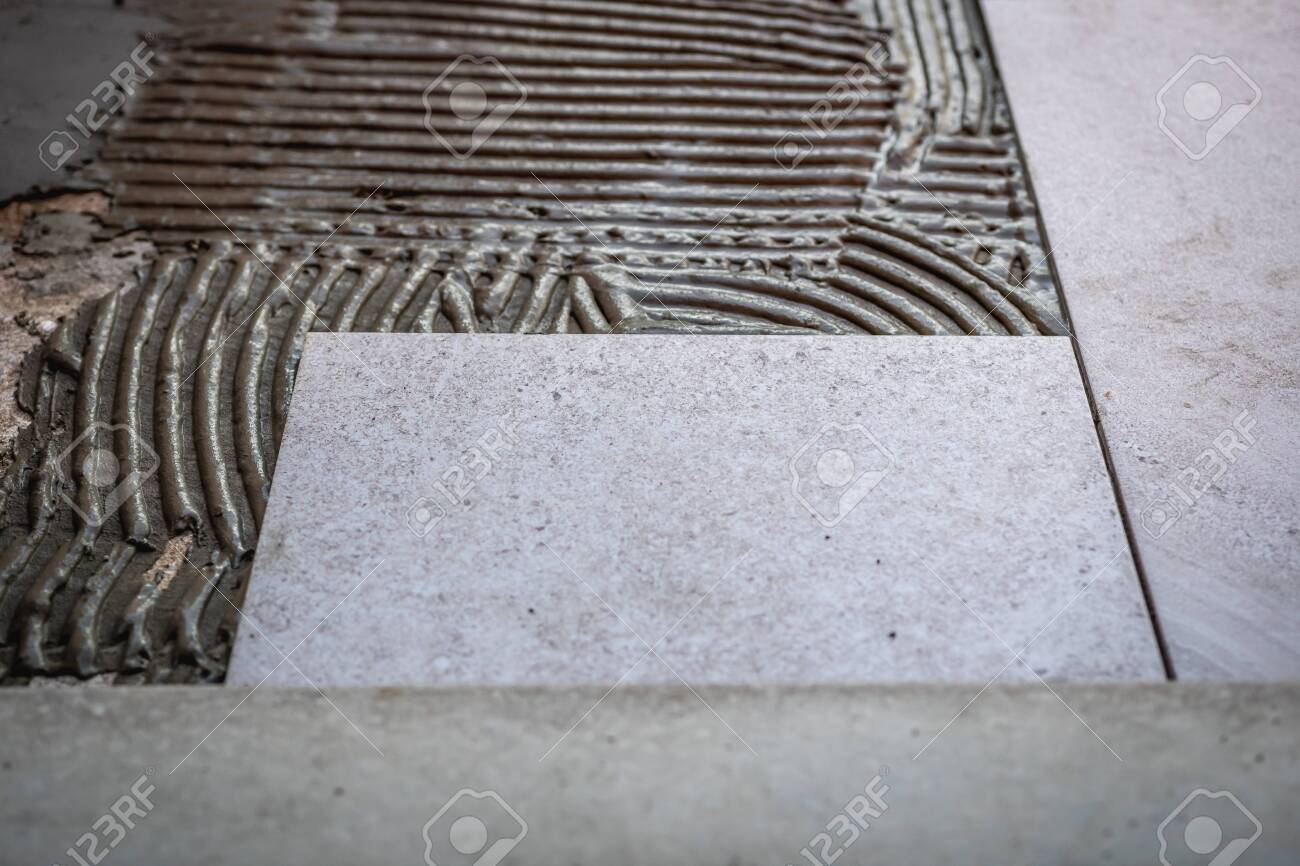 https www 123rf com photo 153222468 tile installation with glue on concrete floor html