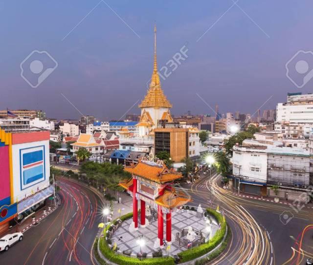 Stock Photo Traffic In Royal Jubilee Gate Landmark Of Chinatown And Wat Traimit Temple Of The Golden Buddha Bangkok Thailand Landmark Of Chinatown In
