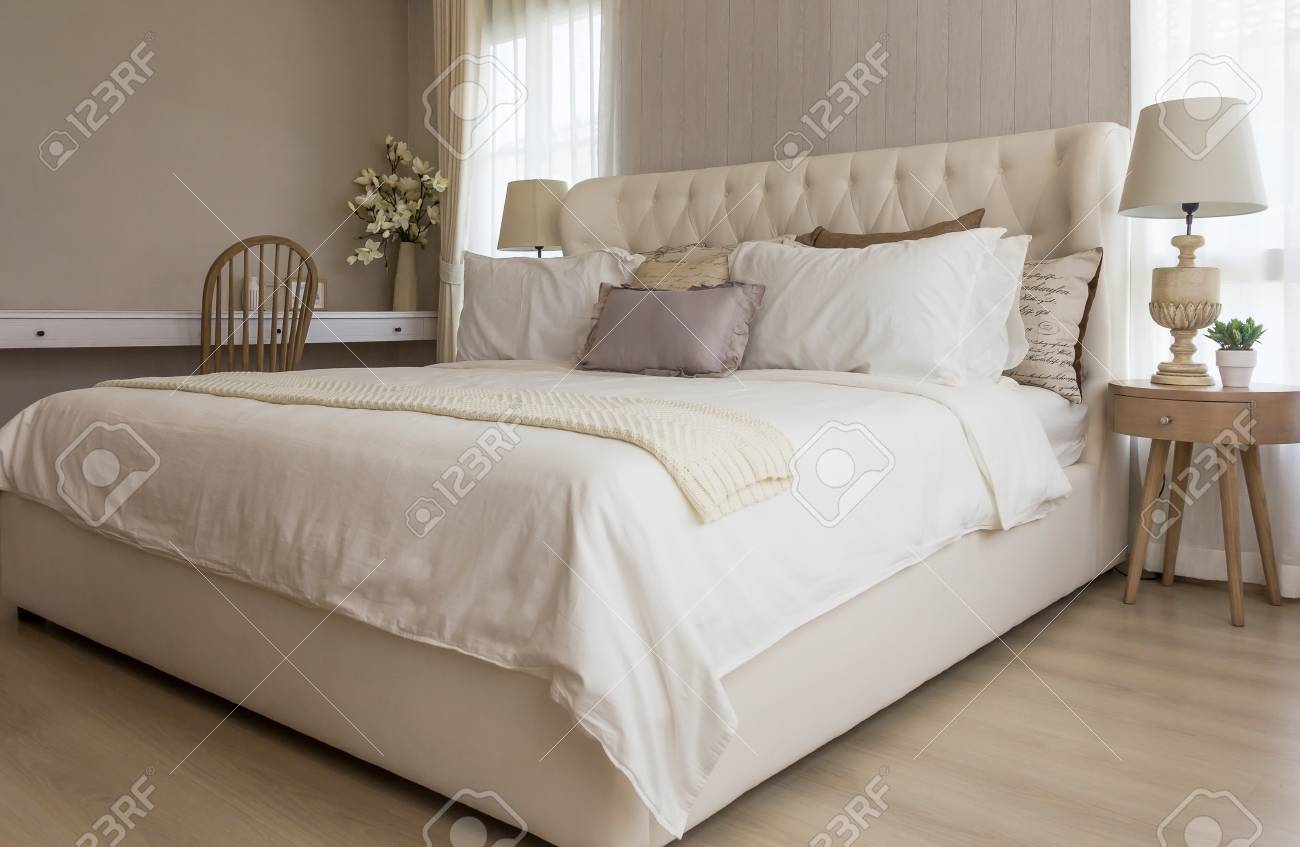 closeup of new bed comfort with decorative pillows headboard