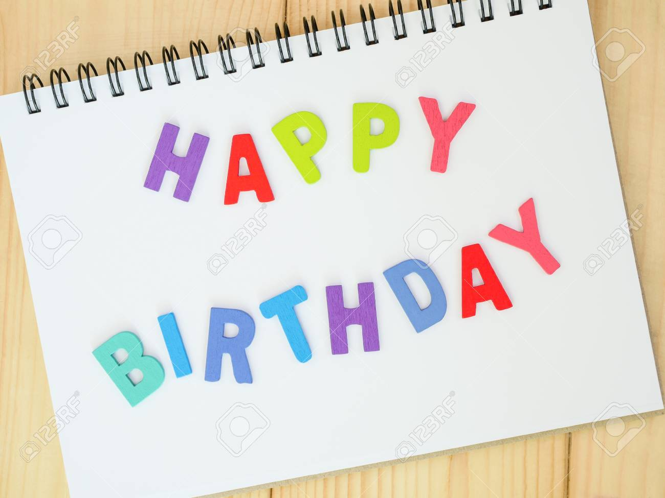 Wooden Word Spell Happy Birthday On Notebook With Wood Background Stock Photo Picture And Royalty Free Image Image 56153913
