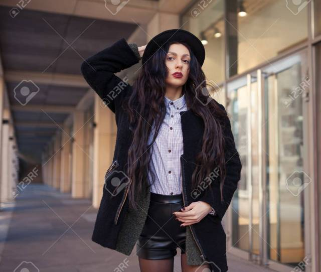 Outdoor Lifestyle Fashion Portrait Of Pretty Young Girl Wearing