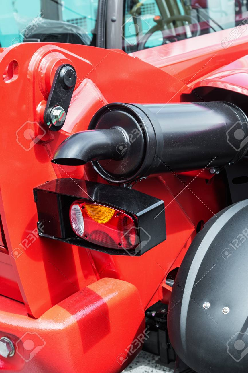 rear lights and exhaust pipe on the tractor or excavator details