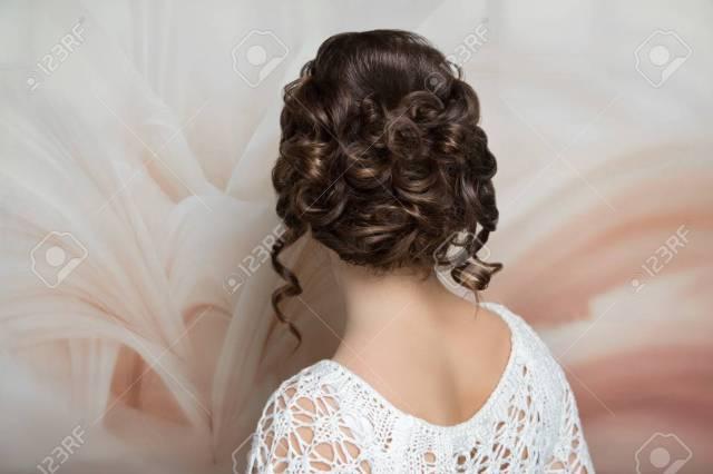 woman brunette medium length hair. wedding hairstyle gathered..