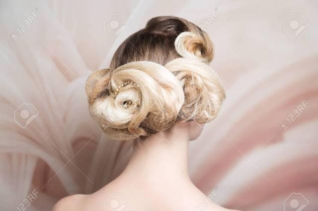 woman blonde medium length hair. wedding hairstyle gathered hair-do..