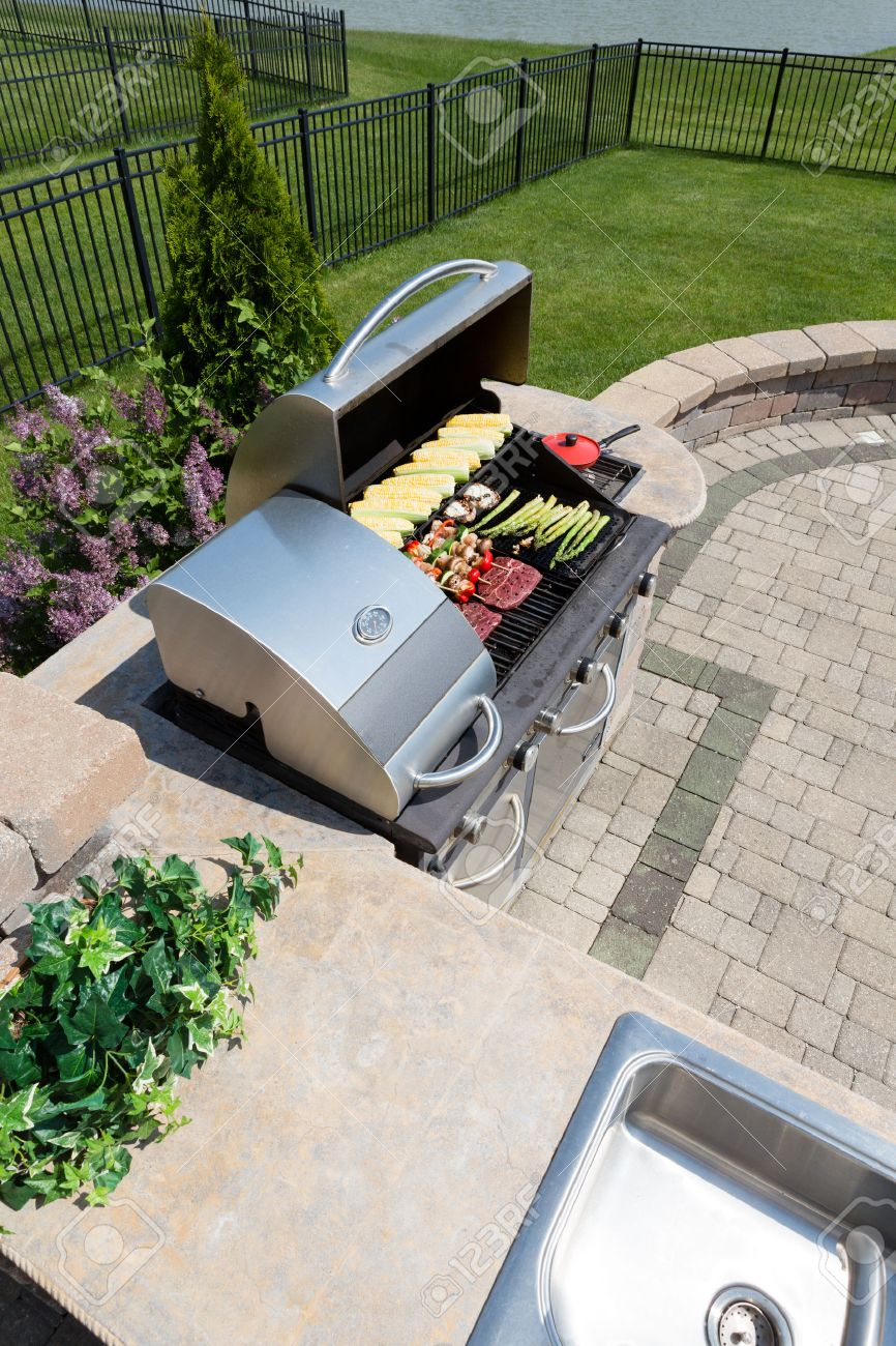 healthy outdoor living cooking in a summer kitchen fitted with