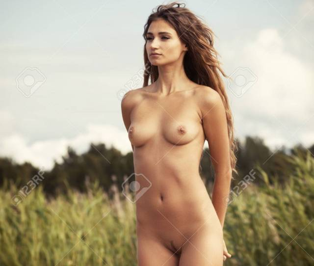 Beautiful Young Nude Woman On Nature Background Stock Photo